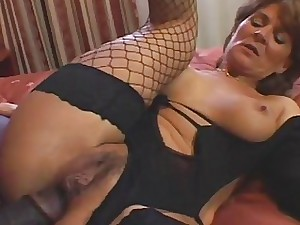 Mature Breezy In Fishnets Takes Dark-hued Pink cigar