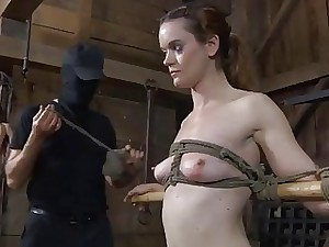 Slaves are made to undress inwards a small cage