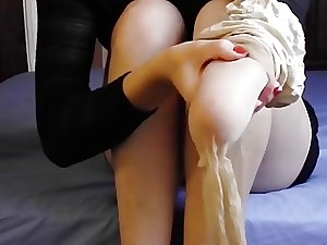Fledgling amputee babe puts pantyhose and stilettos on in close-up