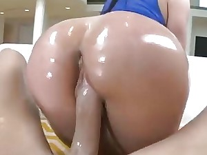 Kendra Lust parades her oiled butt while being fucked strong