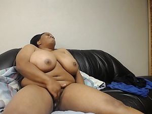 Ebony woman cumming on her couch