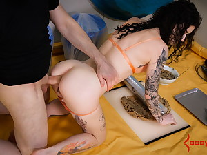 Submissive makes cookies while getting fucked in the ass
